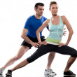 Man aerobic trainer positioning woman Workout — Stock Photo #9001915