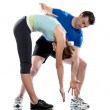 Man aerobic trainer positioning woman Workout — Stock Photo #9001928
