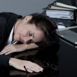 Woman sleeping at work — Stock Photo