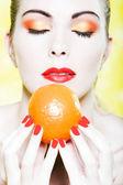 Woman portrait smell orange fruit — Stock Photo