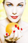 Woman Portrait offer an orange smiling — Stock Photo