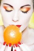 Woman portrait smelling a mandarin — Stock Photo