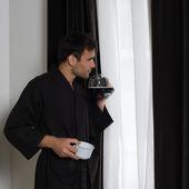 Handsome man in a bathrobe — Stock Photo