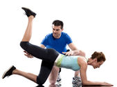 Man aerobic trainer positioning woman Workout — Stock Photo