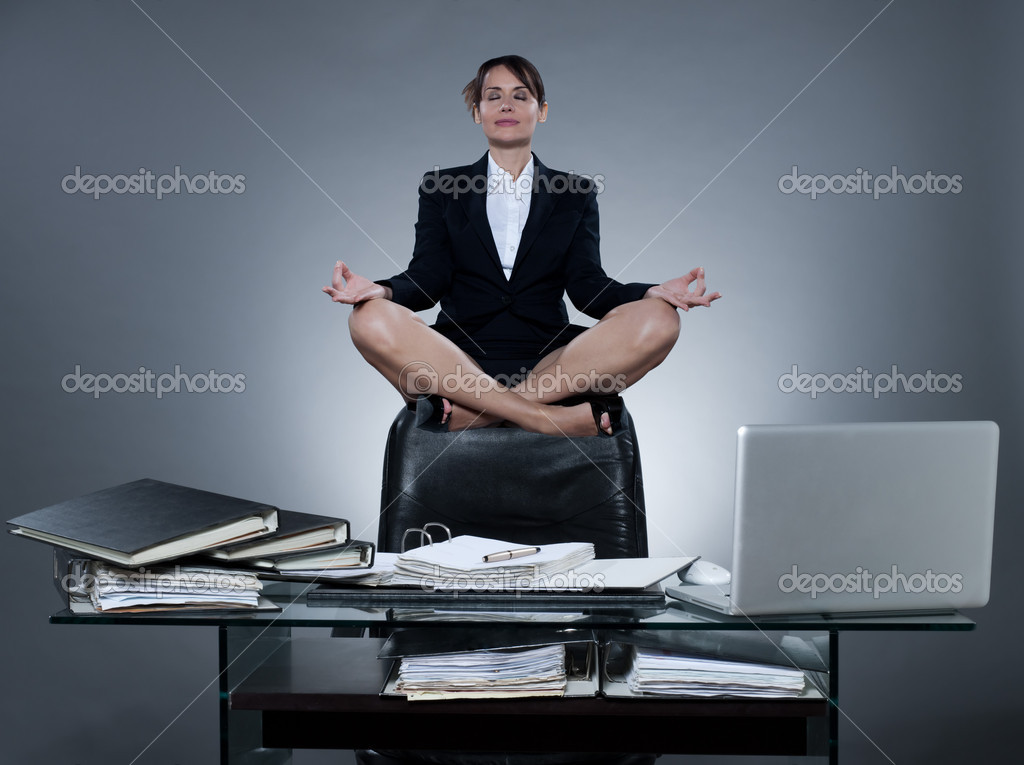 Beautiful cheerful caucasian  business ecretary woman levitate from her desk on isolated background  Stock Photo #9003329