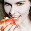 Stock Photo: Woman holding an apple fruit