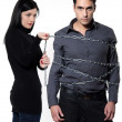 Woman restraining a man chained — Stock Photo