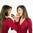 Women sisters eating sharing cakes — Stock Photo #9077081