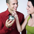 Young couple saving - Stock Photo