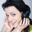 Young woman listening music — Stock fotografie