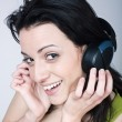 Stock Photo: Young woman listening music