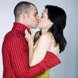 Young couple hugging kissing — Stock Photo