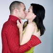 Stock Photo: Young couple hugging kissing
