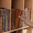 Woman Hands holding ancient books — Stock Photo