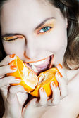 Woman holding citrus fruit — Stock Photo
