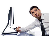 Man chained to computer with handcuffs sad — Stock Photo