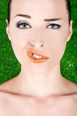 Fashion portrait of a woman pulling a strange face — Stock Photo