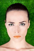 Portrait of a serious beautiful woman with green eyes and glossy — Stock Photo