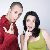 Young couple grimacing — Stock Photo