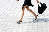 Detail caucasian woman legs running in the street — Stock Photo