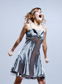 Beautiful young girl with prom dress screaming anger — Stock Photo