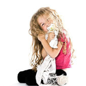 Little girl hugging pacifier and blanket smiling cheerful — Stock Photo