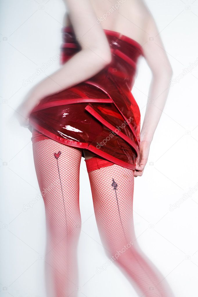 Funny & sexy expressive redhead girl wearing a palstic coat and dress on isolated background from back — 图库照片 #9079222