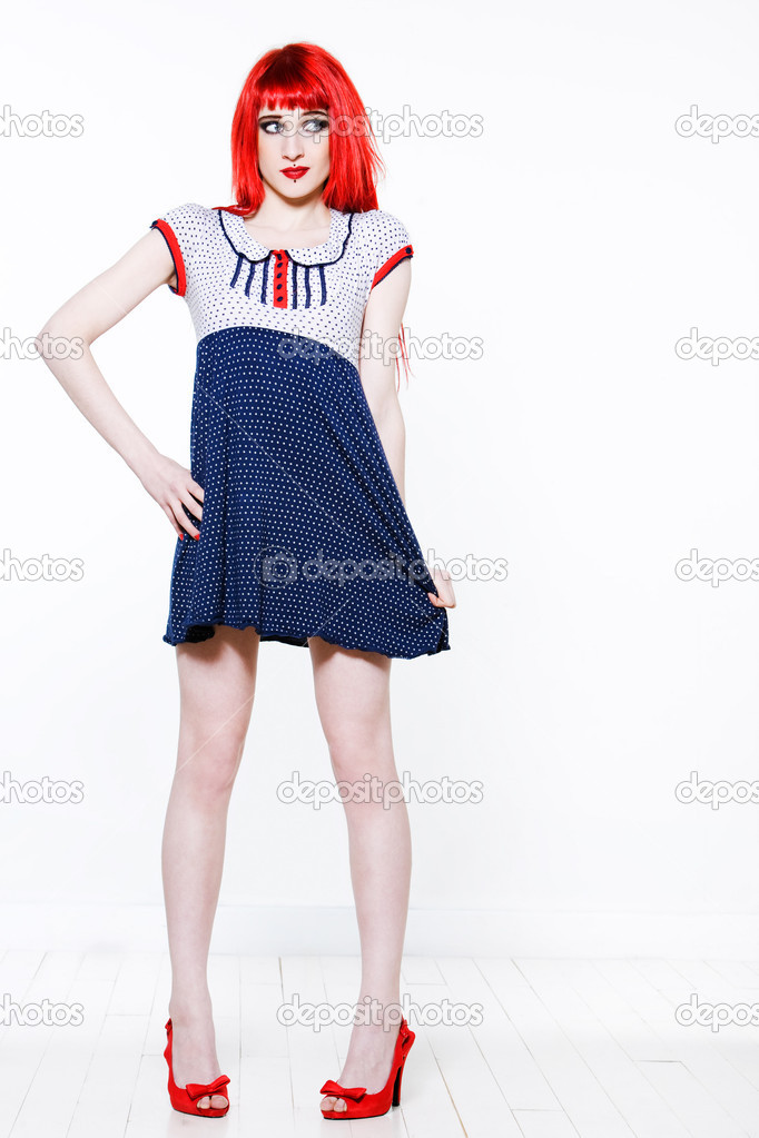 Funny & sexy expressive redhead girl wearing a palstic coat and dress on isolated background — Stock Photo #9079243