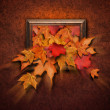 Stock Photo: Fall Leaves Coming Out of Antique Frame