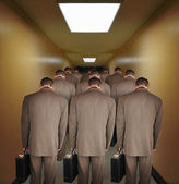 Overworked Business Men Walking down Hallway — Stok fotoğraf