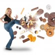 Diet Woman Kicking Donut Snacks on White — Stock Photo #10628317