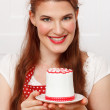 Woman holding a cupcake — Stock Photo