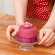Woman with cupcake — Stock Photo