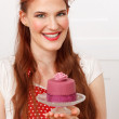 Woman holding cupcake — Stock Photo