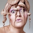 Woman with octopus - Stock Photo