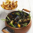 Mussels with French fries — Stock Photo