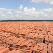 Stock Photo: Warehouse of bricks in field conditions