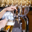 Waiting woman pouring beer — Stock Photo #10144547