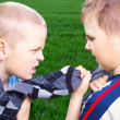 Stock Photo: Children fighting over a sweater