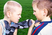 Children fighting over a sweater — Stock Photo
