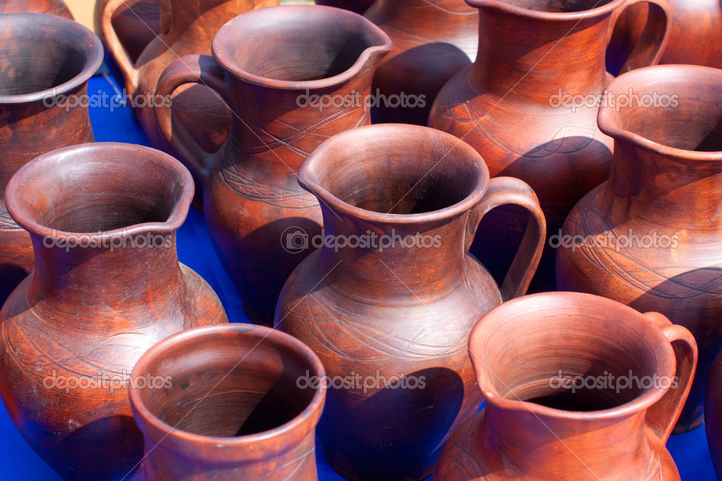 National culture ceramic handmade brown jugs on market — Stock Photo #10450585