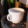 Stock Photo: Coffee machine and cup