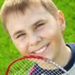 Boy with badminton racket — Stock Photo #10677104