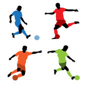 Four soccer players silhouettes — Stock Vector