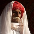 Old Indian cameleer with red turban — Stock Photo