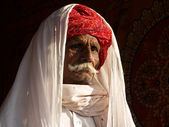 Old Indian cameleer with red turban — Stok fotoğraf