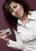 Young and beautiful woman with camera — Stock Photo
