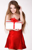Beautiful girl with a gift. On a white background — Stock Photo
