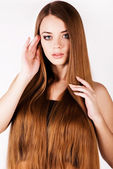 A beautiful young girl with a long hair — Stock Photo