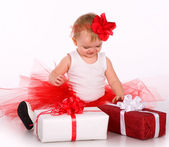 Cute baby playing with a toy and gift — Stock Photo